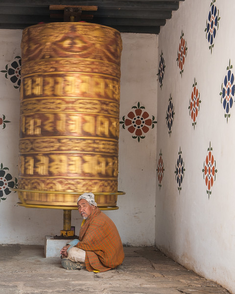 Old Man with Spinning Prayer Wheel