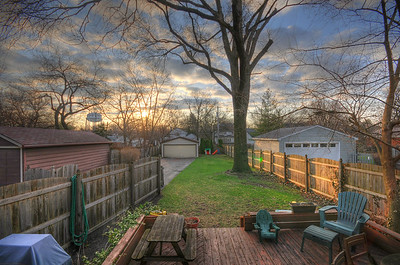 time to paint the deck? HDR Sunrise in the back yard with a bit of green lens flare on the right side fence.