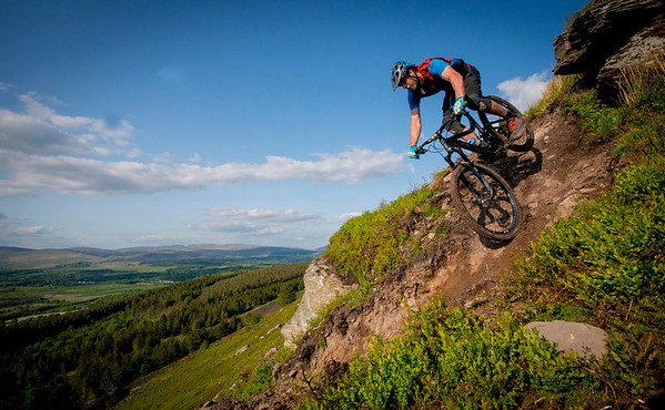 6th July 2020, Brecon Beacons, Wales.  A mountain biker rides a trail down a hill on the edge on the Brecon Beacons in South Wales on a clear evening, as mountain bike trails open across Wales and the five-mile travel restriction is lifted. There is expected to be a influx of visitors to Wales as tourist head for the hills and coast.  Credit : Robert Melen/Alamy Live News.