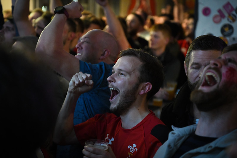 Wales v England Six Nations, 2019 Cardiff, 23rd February 2019.<br /> <br /> Welsh fans in Cardiff city centre watching Wales' Six Nations game against England. <br /> <br /> Fans celebrate as Wales go ahead in the match.