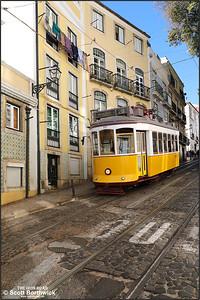 557 descends the Calçada de São Vicente in the Alfama district of Lisbon with a No.28 service to Prazeres on 14/11/2017.