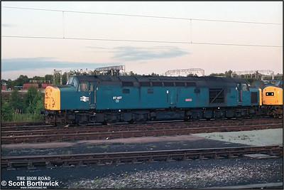 97407, the former 40012 'Aureol' stands on Crewe Diesel (CD) on 21/07/1985.