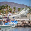 Casting the fishing net, Loreto Harbor, Mexico