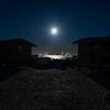 The full moon setting over Kuyimà Whale Camp, San Ignacio Lagoon