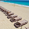Empty lounge chairs on the beach