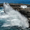 Waves crash against the small island off the west coast of Rapa Nui near Ana Kakenga.