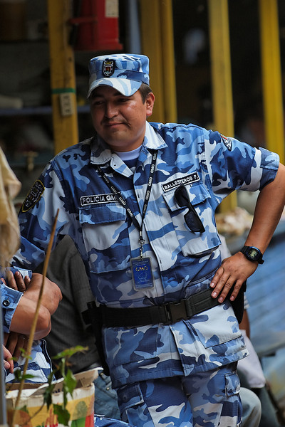Otavalo Market - The face of a policeman is the same all over the world, but the BLUE camouflage is quite unique.