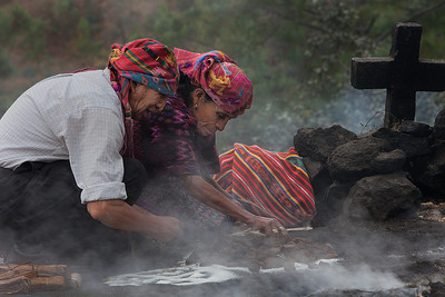 Shamans making offering on top of the sacred hill in Chichicastenango.