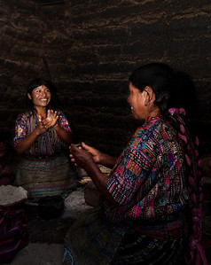 Traditional household, making tortillas.