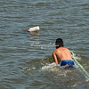 Deckhand pulling a rope towards the mooring, Ferry, Ometepe Island