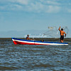 Casting a net from a boat, Lake Nicaragua