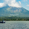 A ferry crosses beneath Mt. Concepcion one of two volcanoes on Ometepe Island