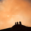 Silhouettes on the edge of the Masaya Volcano crater