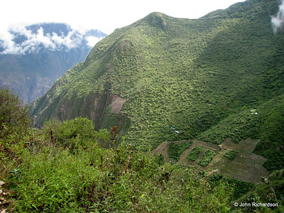 View of terracing, Choquequirao at saddle and valley beyond