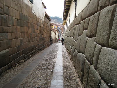 Intricate Inca wall on right side in Cuzco (Spanish wall on left)