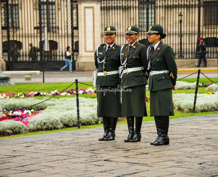 Three policewomen standing on Plaza Mayor, Lima, Peru