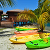 Kayaks on the beach for all guests to use