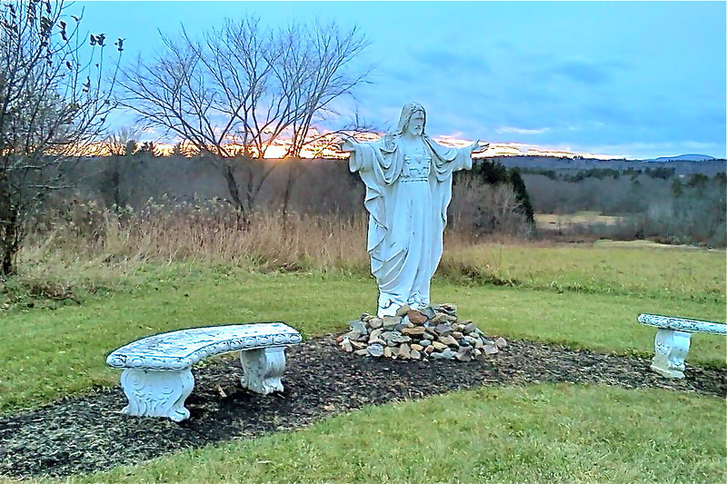 Sacred Heart welcomes hikers and the benches invite them to rest<br /> <br /> Credit: Roseanne T. Sullivan