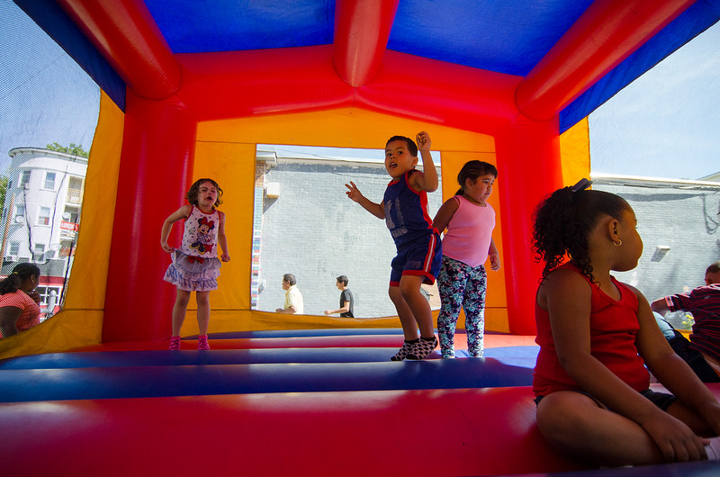 Kids play in a bouncy house during the Latino Heritage Month Festival put on by the United Neighbors of Fitchburg on Saturday afternoon. SENTINEL & ENTERPRISE / Ashley Green