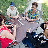 Residents play dominos during the Latino Heritage Month Festival put on by the United Neighbors of Fitchburg on Saturday afternoon. SENTINEL & ENTERPRISE / Ashley Green
