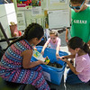 Kids play in a bucket of worms provided by Growing Places during the Latino Heritage Month Festival put on by the United Neighbors of Fitchburg on Saturday afternoon. SENTINEL & ENTERPRISE / Ashley Green