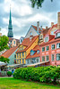 A city square with colorful buildings and flowers in the old city of Riga, Latvia.