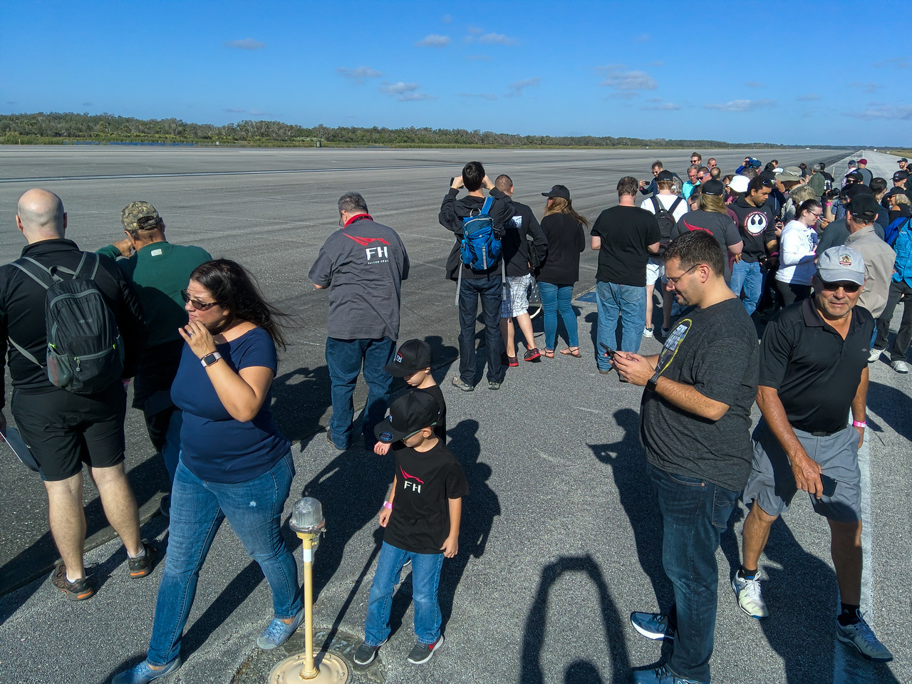 Letting the tourists off of the busses for a walk on the runway.