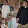 Showing Justin she has her flower girl basket - I think he's thinking about other things more important!