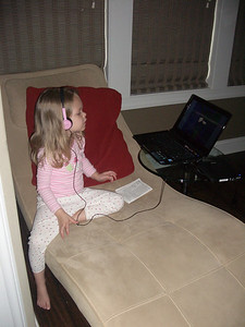 Mariah watching a movie with her new headphones