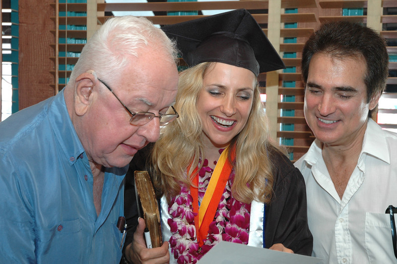 Dad, Laura & Jim check out the diploma