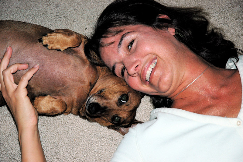 Patti and her smiling  dachshund