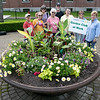 The Laurelwood Garden Club as its civic beautification project for the fifth year planted an array of full blooming vibrant colorful flowers in the 18th century 3,000 pound cast iron water basis used in the historic civil war era as a horse trough now located in Renaissance Park next to the Fitchburg City Hall on Main Street. /From left is members Lucille Cormier, Tisha Schiavitti, Mary Ciuffetti, Sara Gammell, Tom Gammell, Katheryn Nowosielski, Julie Palioca and Deb Vilandry. SENTINEL & ENTERPRISE/JOHN LOVE