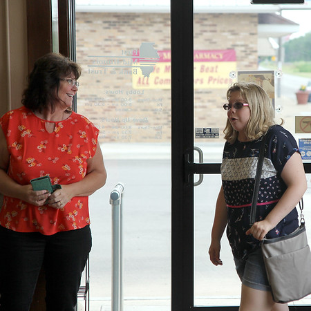 Lee Ann Greuel smiles as her daughter, Lauren Greuel, reacts at the celebration put together for her 21st birthday at the First Mid-America Bank and Trust in Neoga on Friday, June 8, 2018. Lauren was born with multiple life-threatening disorders and was not expected to live past age seven. Lauren was at a loss for words, hugging her visitors and thanking them for showing up. Graham Milldrum photo