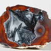 """#A046 Thunder Egg, Lava Cap Claim, Little Florida Mtns., Deming, New Mexico USA<br /> Speaking of painterly agates this one is certainly hot. It also has wonderful psuedomorphs and the seed at the right shades back and forth in many colors.<br /> 3 x 2 x 1"""" 0.28 lb<br /> All agates in the Sample Gallery have been sold."""