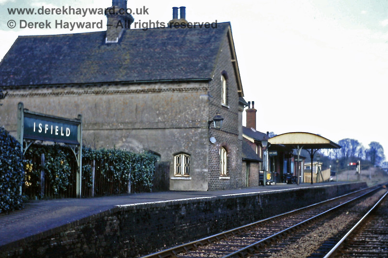 Isfield main station buildings, looking north, with the Station Master's house and running in board nearest to the camera. 23.02.1969.  Eric Kemp retains all rights to this image.