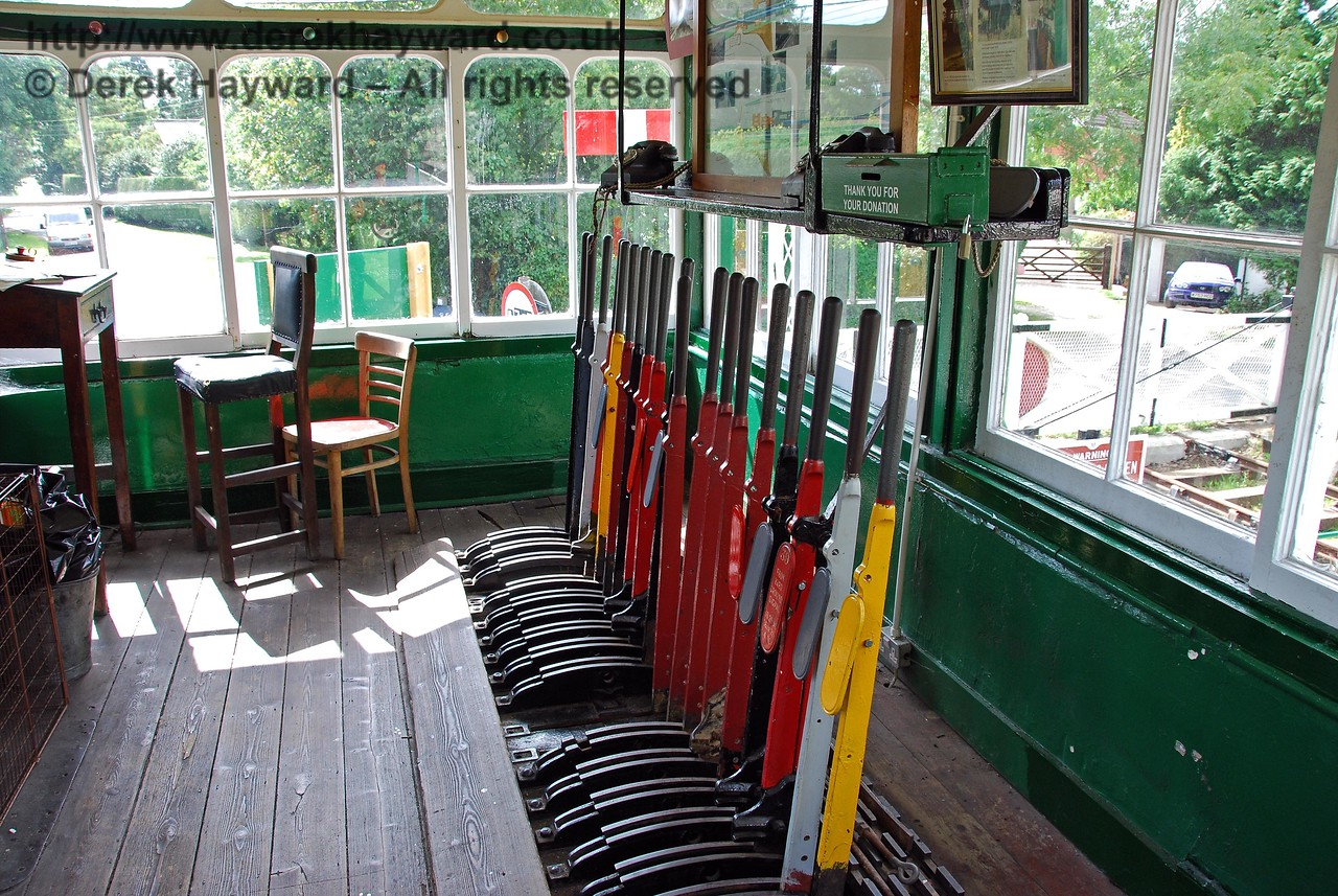 The lever frame in Isfield signal box.  This is not currently in use, but one lever operates the signal outside the box for demonstration purposes. 02.09.2007