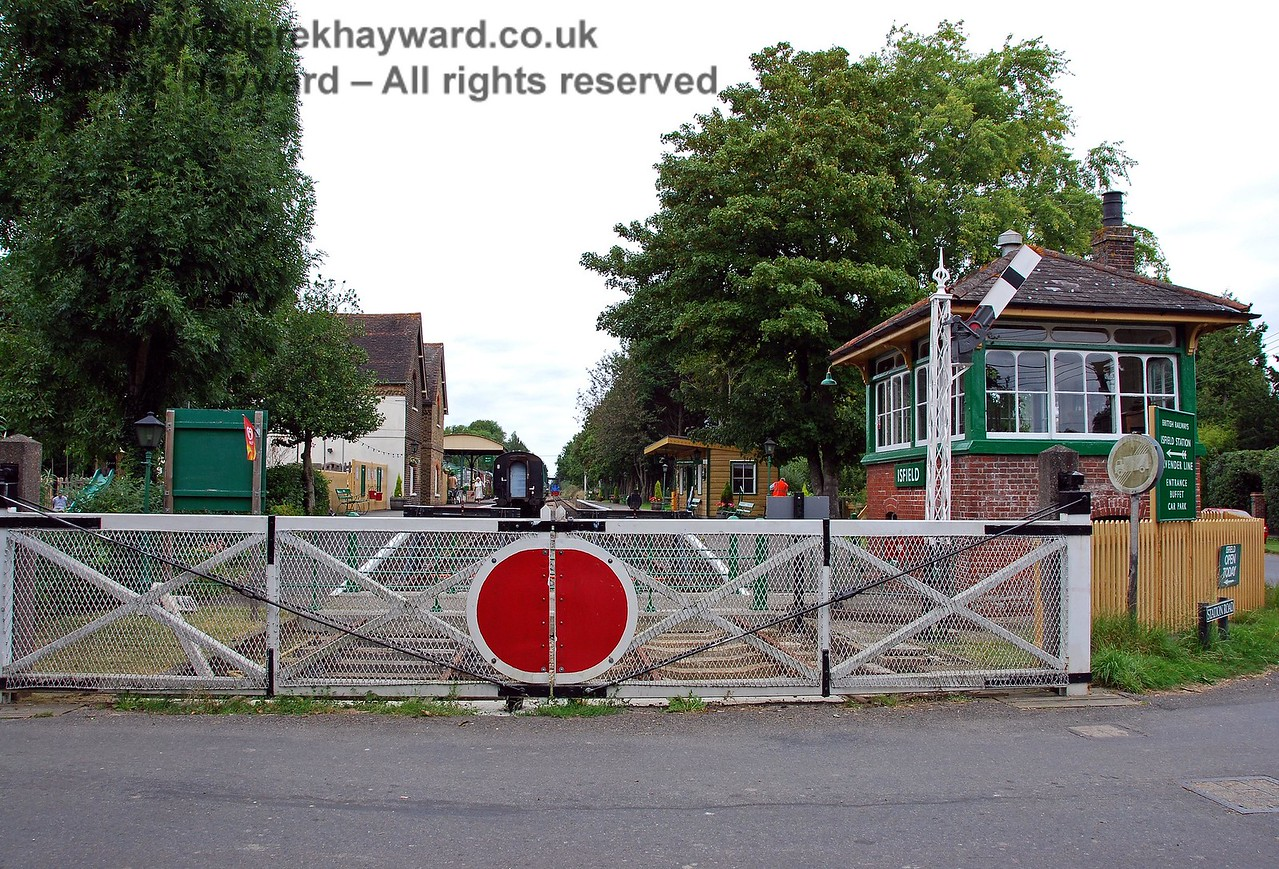 The remains of the level crossing at Isfield.  Both the crossing and the signal box are now listed.  The rather alarming Off indication on the signal results from children learning how to operate the levers! 02.09.2007