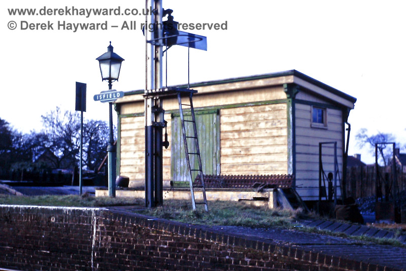 Isfield goods shed and Up starting signal, pictured on 23.02.1969.  Eric Kemp retains all rights to this image.