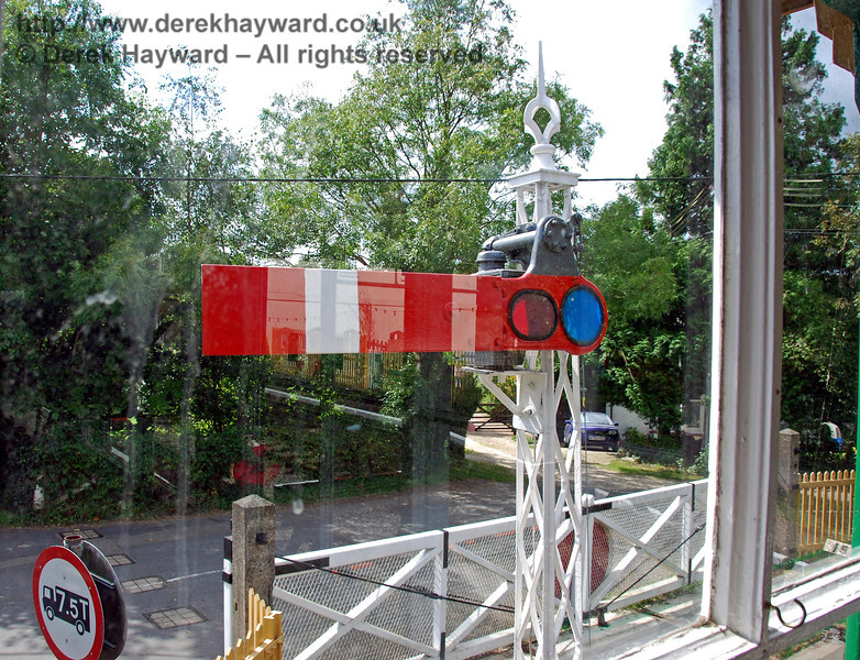 The former starting signal for southbound services, with the signalman's view across the crossing to the disused line south (now a private garden). 02.09.2007