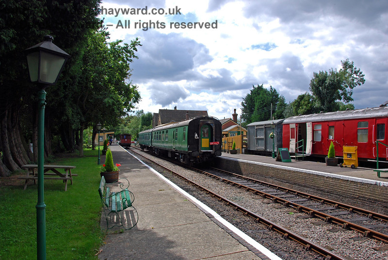 Looking south along the platforms at Isfield with the red museum coach in the background. 02.09.2007