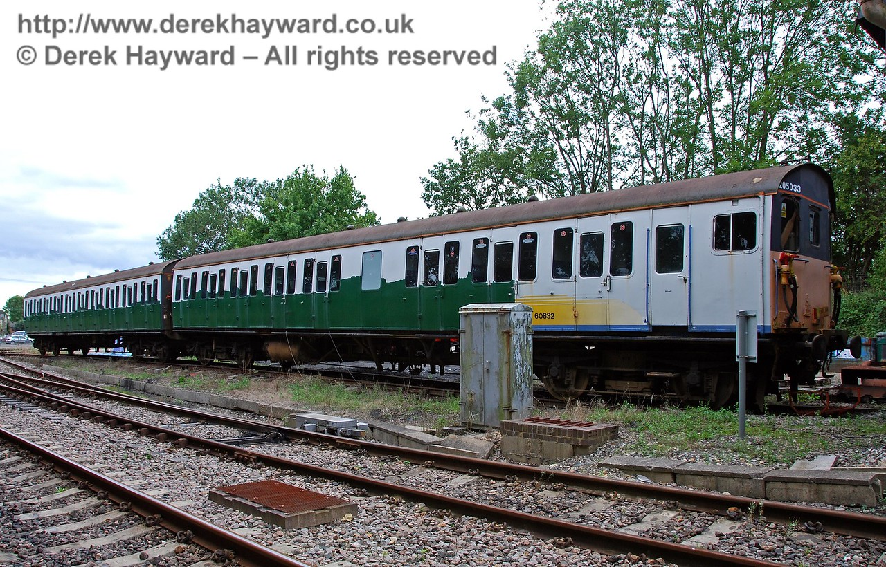 The remaining two coaches from 205033 (centre car 60678 and trailing car 60832) were outside the shed, and repainting was in progress. 02.09.2007