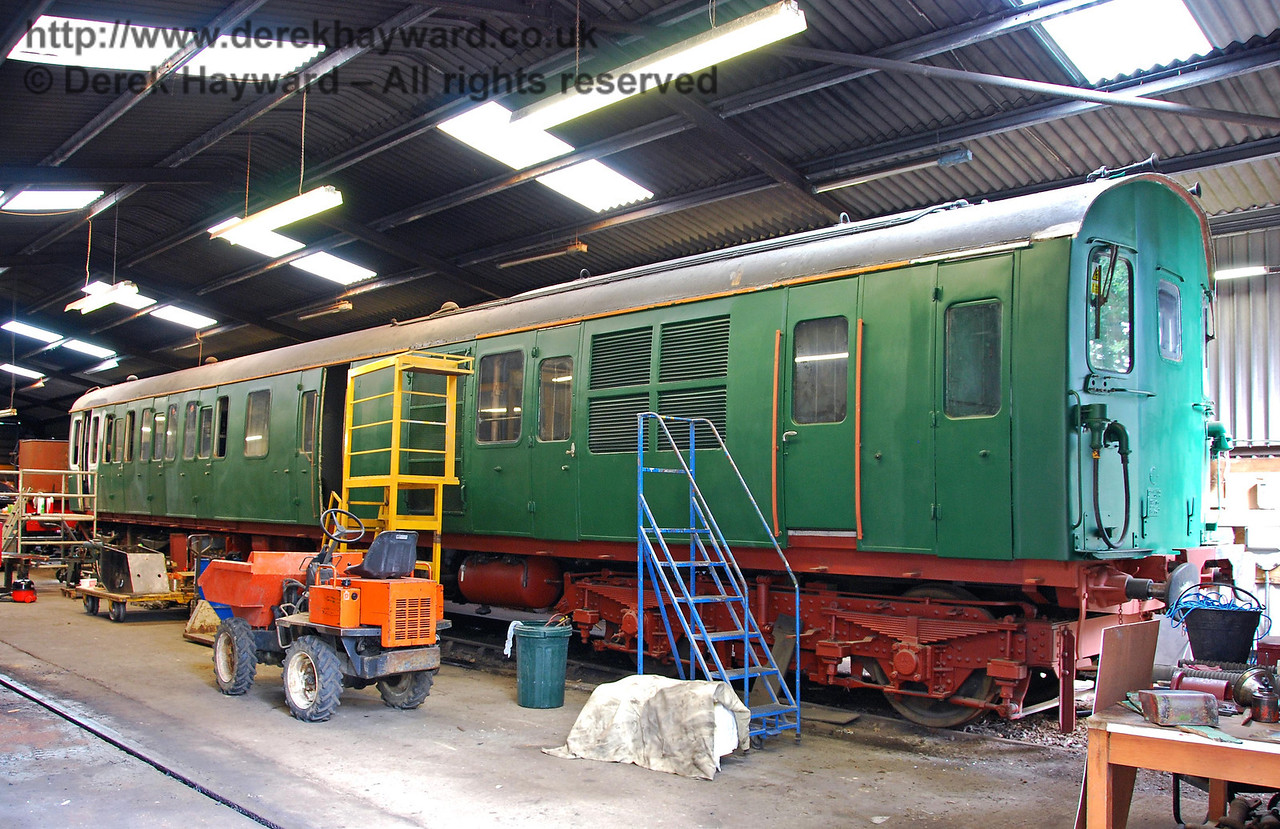 Driving car 60151 from Thumper 205033 under restoration in Isfield shed. 02.09.2007