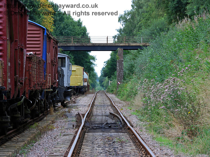 Still looking north, trains pass the goods wagons stored at Isfield.  Individual photos of each wagon are in a separate collection. 02.09.2007