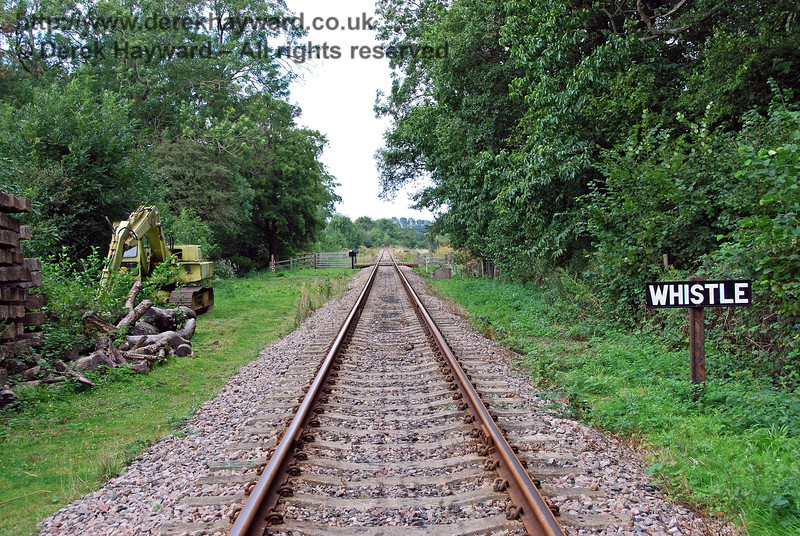 The approach to the foot crossing, with the usual Whistle command on the right. A digger stands ready for PW works on the left. 02.09.2007