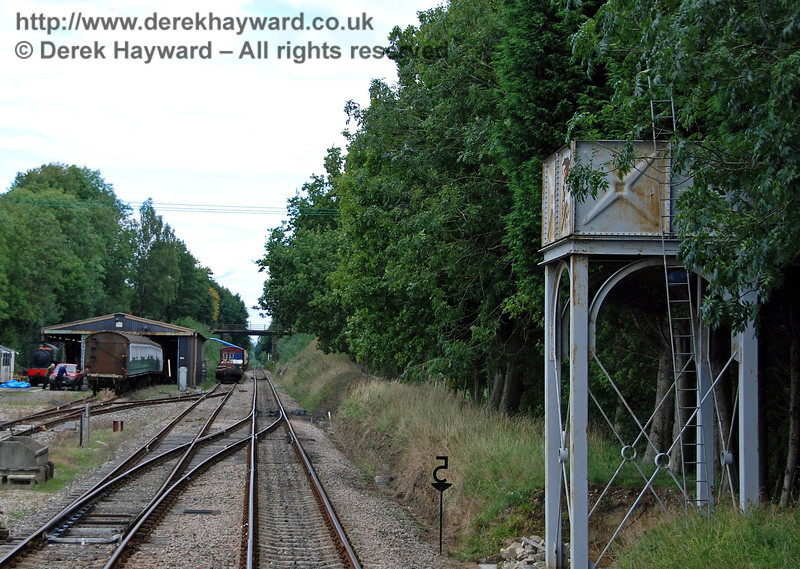 Leaving Isfield Station heading north, the water tower is on the right, with the shed and a siding on the left. 02.09.2007