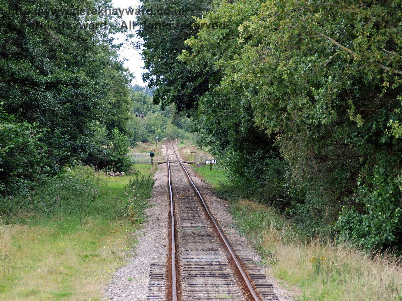 Further north, this view from the front of a train shows a public foot crossing in the distance. 02.09.2007
