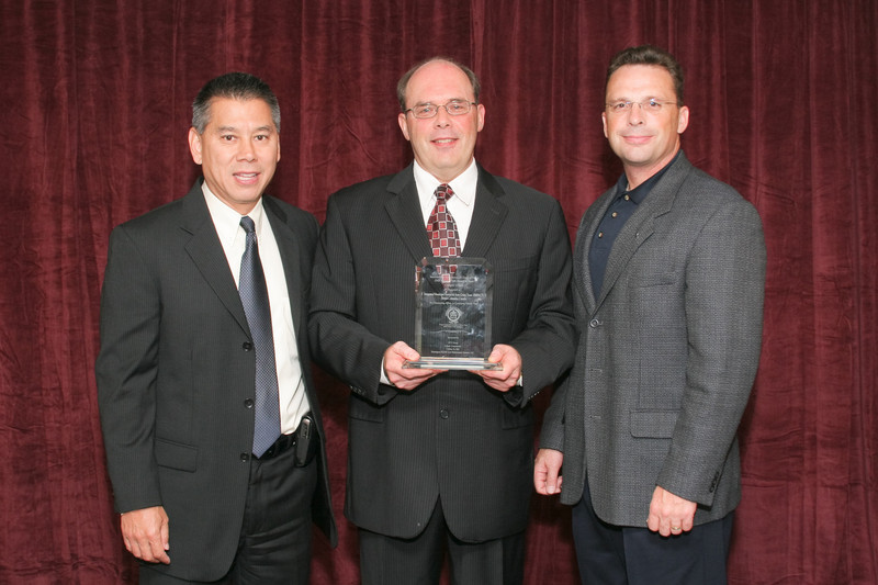 2007 Vehicle Theft Award of Merit -- Category 4 (Multi-Agency Task Forces) Winner:<br /> Integrated Municipal Provincial Auto Crime Team (IMPACT)<br /> Inspector Wayne Holland, Officer-in-Charge<br /> (also pictured: Deputy Commissioner Joe Farrow, California Highway Patrol and George Baker, OnStar by GM)