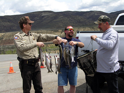 Utah Conservation Office Alan Green checks fish, anglers