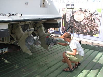 Utah Division of Wildlife Resources Technician Roas Hoban examines a boat for mussels. This photo was taken at the Wahweap Marina at Lake Powell.  Photo by Wayne Gustaveson, Utah Division of Wildlife Resources on 8-12-08.