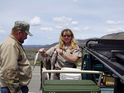 Utah Conservation Officer Stacey Jones checks anglers